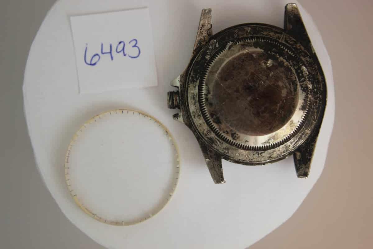 Badly damaged Rolex case in for laser welding.